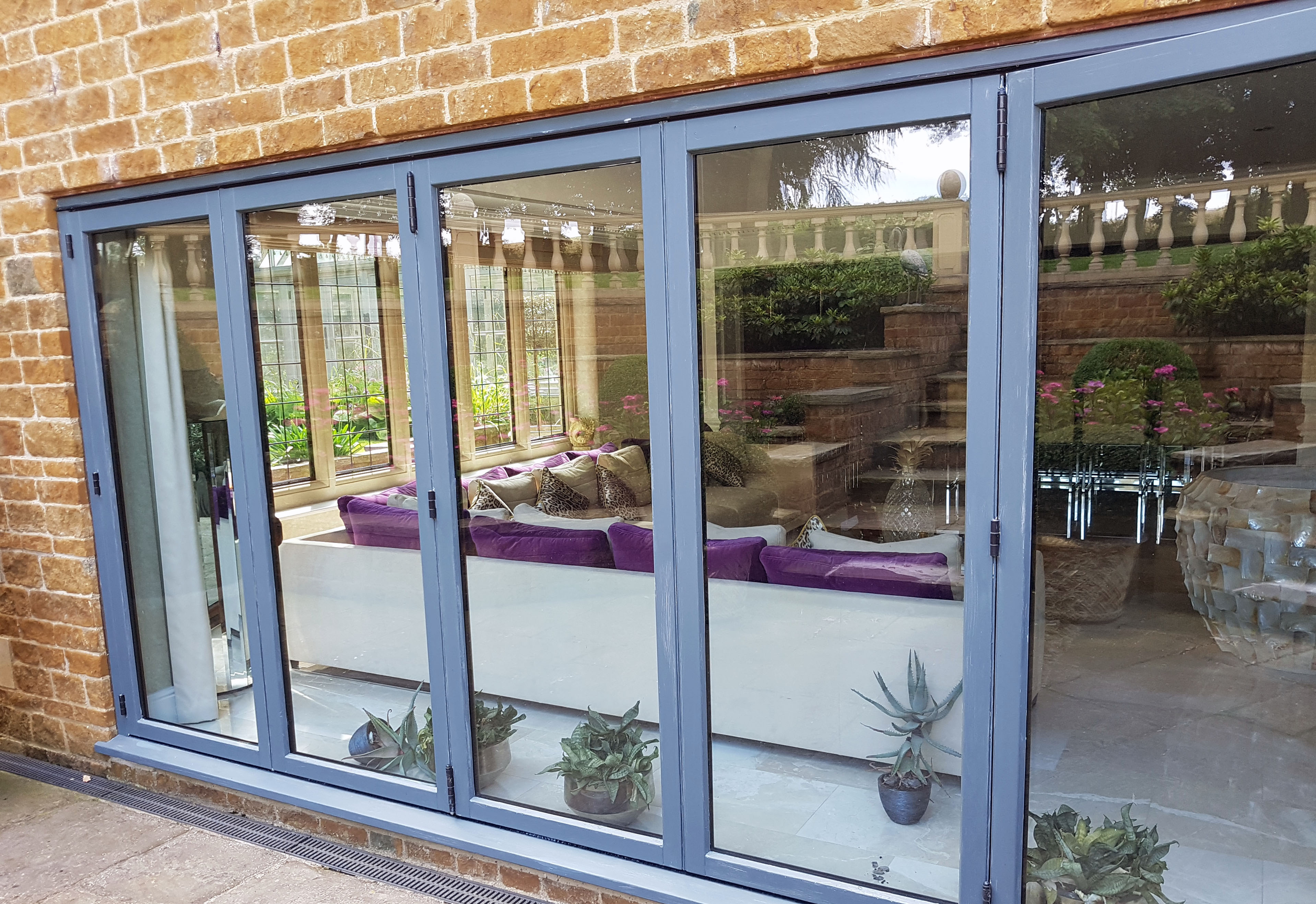 Mark Rogers Decorating tri-fold doors after
